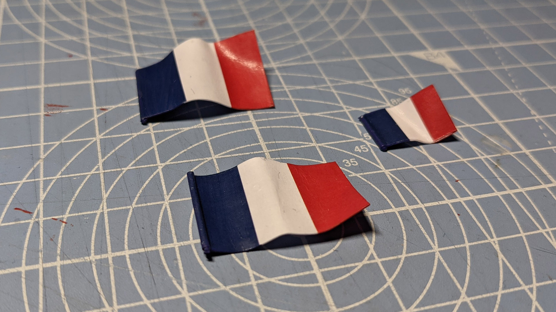 Flags after being curled. This picture also shows off the painted edges, which really help give your flags a professional look.