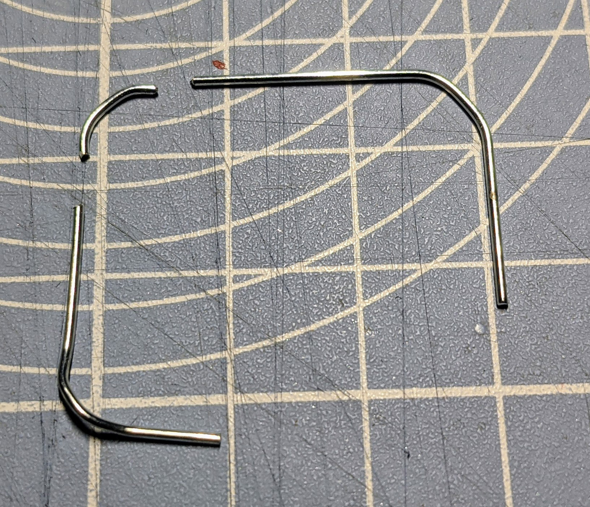 Cut the paperclip as shown to produce two L shapes.