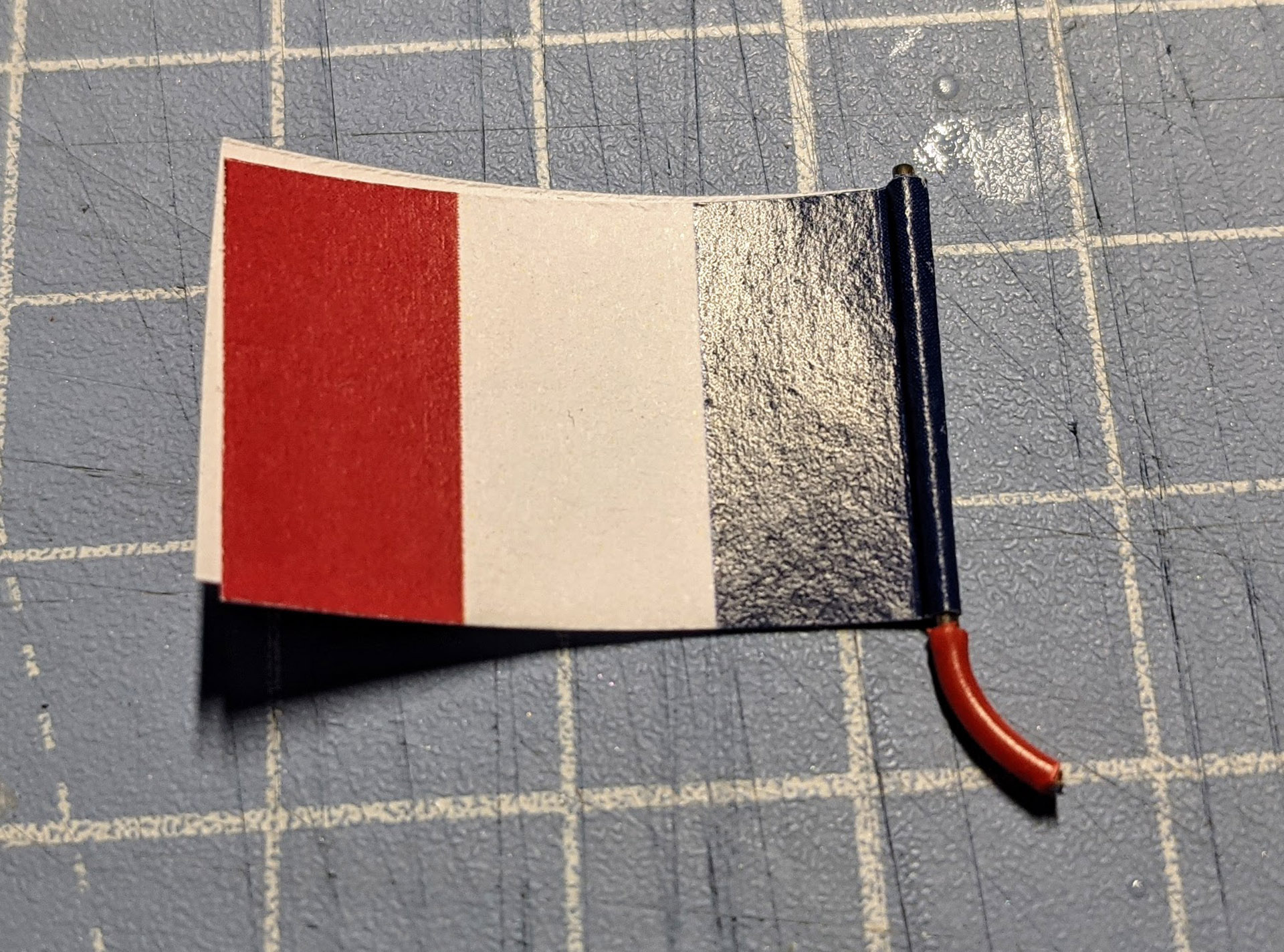 This is a very bad example of the flag not lining up perfectly. To fix this trip the flag until the edges match.