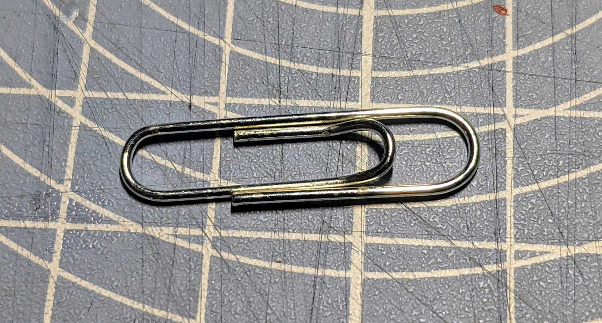 Any normal paperclip will work.