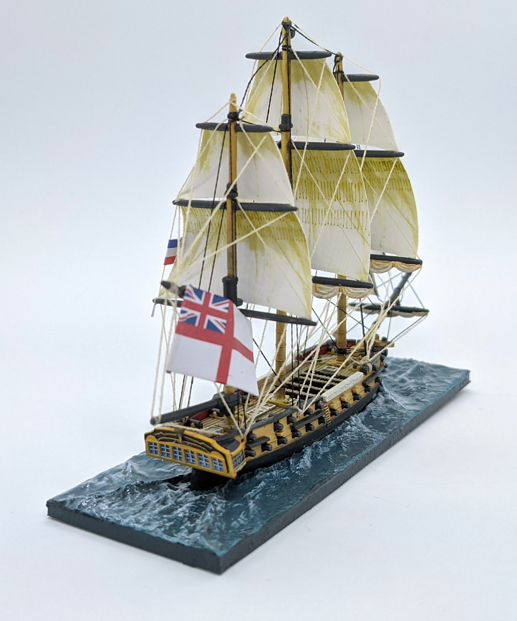 Post 1800 Act of Union Frigate sailing in the White squadron. The flag is attached to a magnet at the top. Part of the paperclip can be seen at the bottom of the flag.