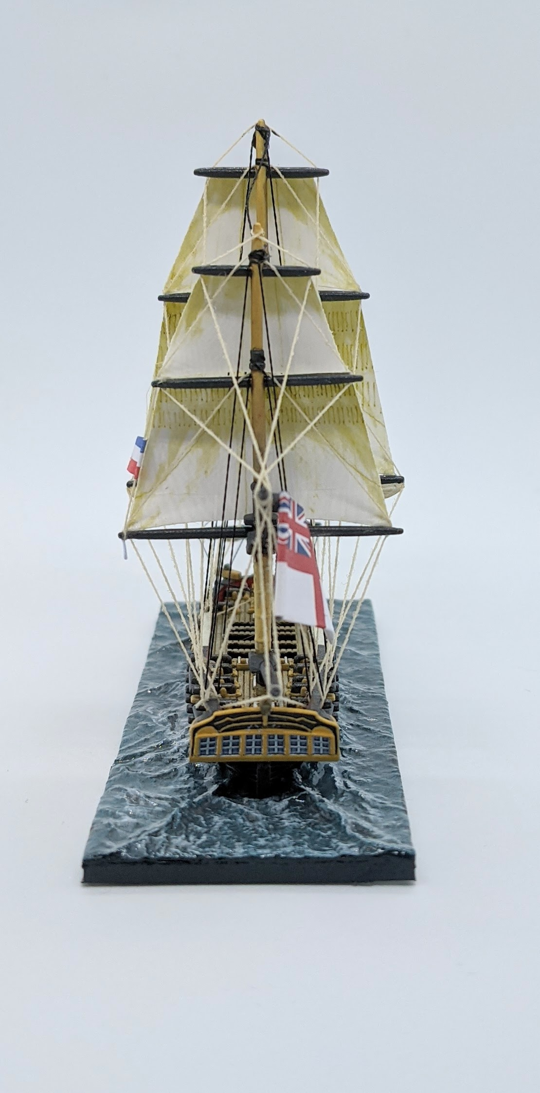 Rear view of the same ship showing how the flag is curled to make it look like it's flapping in the wind. This picture highlights the importance of painting the edges of the flag to hide what would be the white of the paper. Although taking some time, it is an easy way to take the flag to the next level.