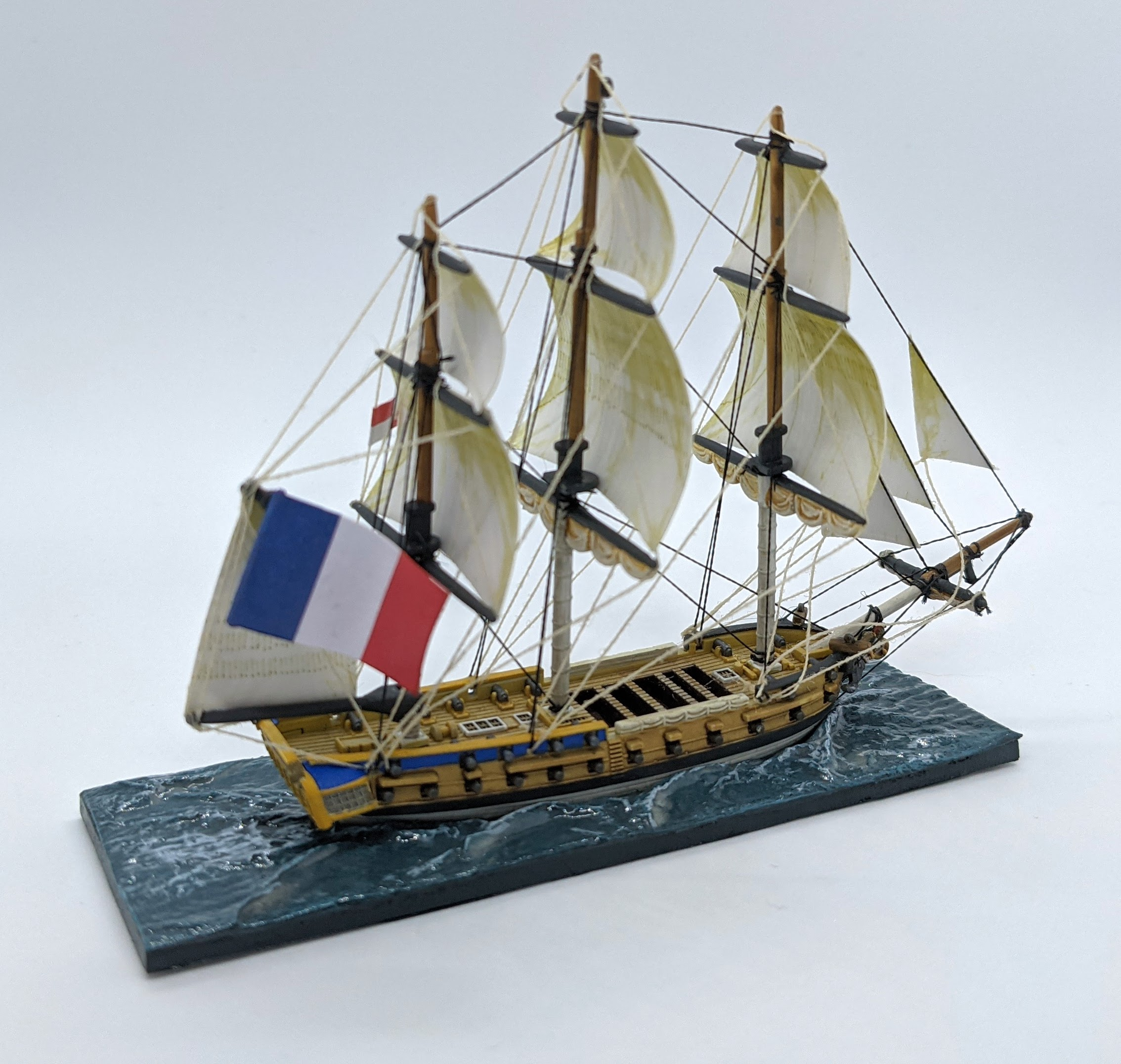 Napoleonic French Flag on a frigate model. The smaller signal flag (used to match the model with the ship card) is permanently attached to the model.