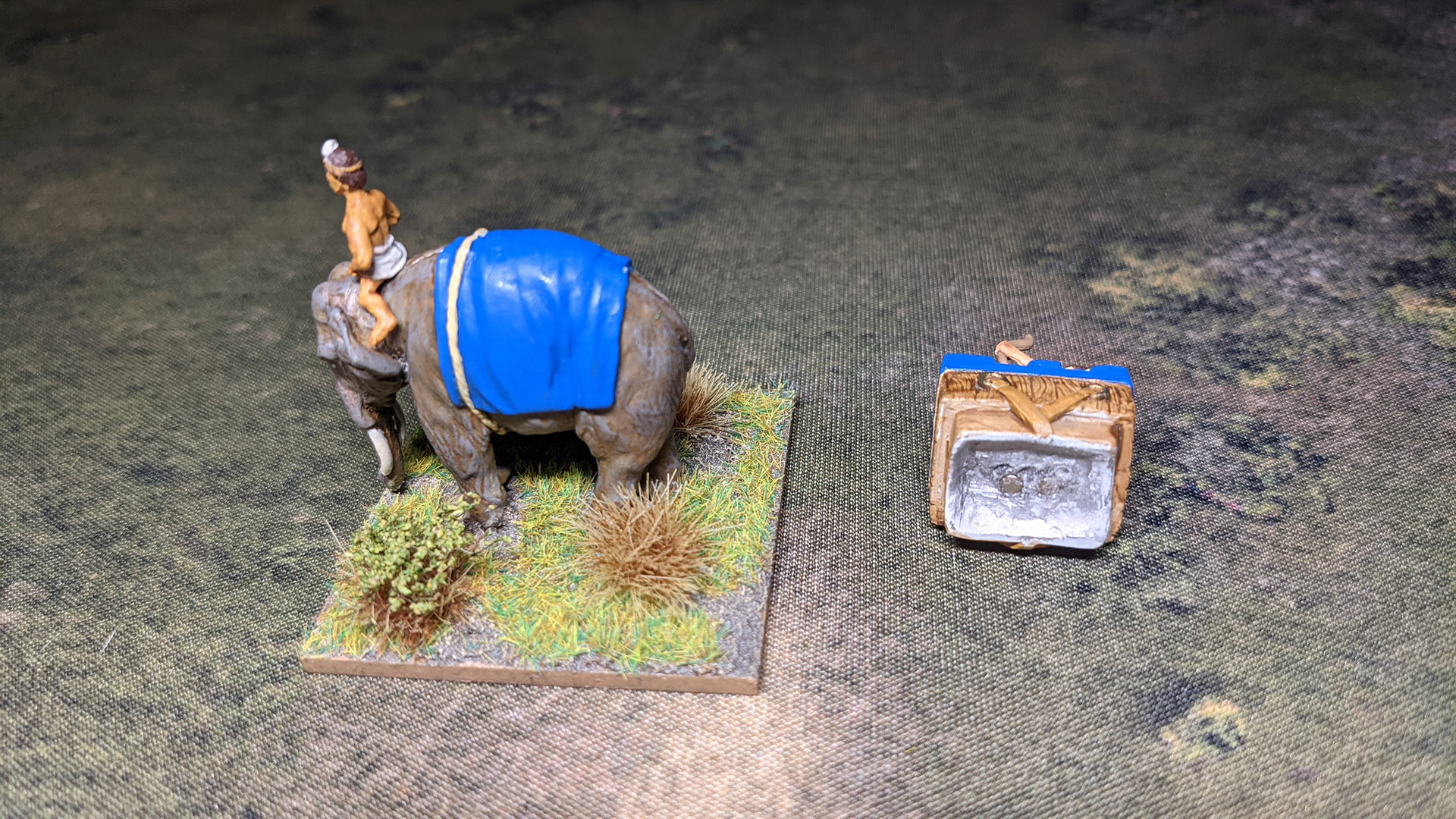 I have placed 2mm magnets in the elephant and howda models so they can be removed for storage. With the elephant I used green stuff to hide the magnet and painted it up so the model can be used without the howda for another army.